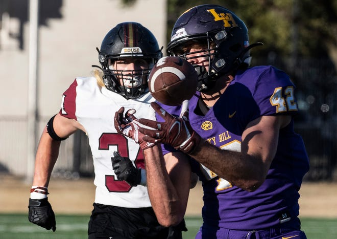 Liberty Hill senior Blake Simpson bobbles but holds on to this 43-yard pass during a 56-42 victory over Rouse in a Class 5A Division II playoff game Saturday. He rushed for 325 yards to earn Statesman player of the week honors.
