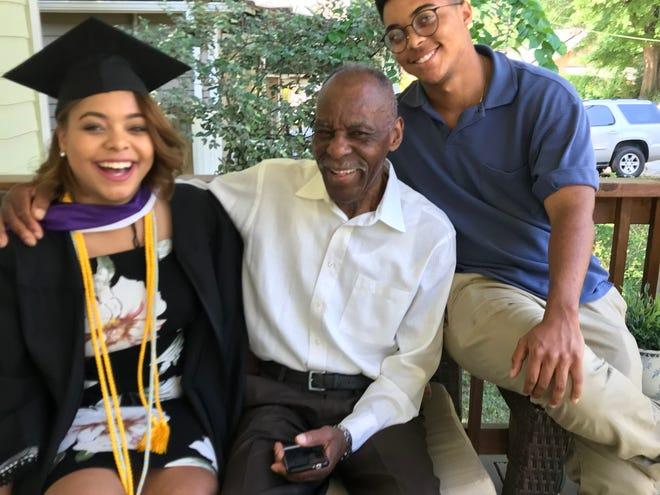 Taylor Stewart, Dr. Ernest Stewart and Sydney Stewart celebrate Taylor's graduation from Agnes Scott College in Decatur, Georgia, in 2017.