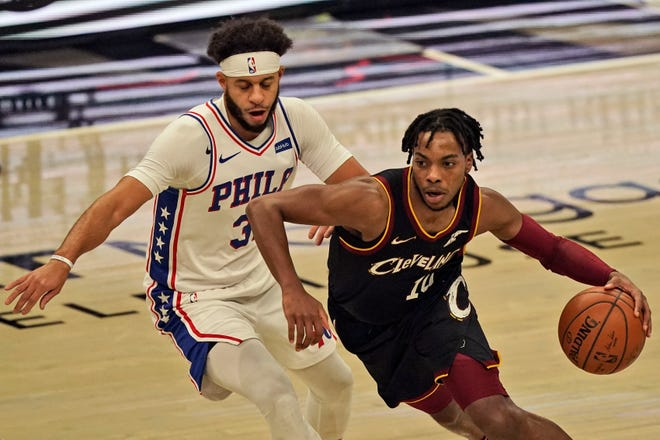 Guard Darius Garland (10) is one of several key players missing time with injuries for the Cavaliers. Dante Exum joined Garland, Kevin Love, Isaac Okoro, Matthew Dellavedova, Dylan Windler and Kevin Porter Jr. on the sideline when he injured his calf Monday night. [Tony Dejak/Associated Press]