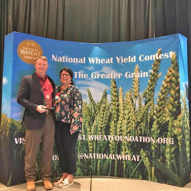 In early 2020, C.R. Freeman and his wife, Carrie, accepted an award from the National Wheat Foundation for having the top producing wheat in Oklahoma, which out-yielded the local county average by 333 percent. He was back in the winner's circle again this year, placing second nationally with a field that yielded 100.6 bushels per acre and exceeded the county average by 308 percent.