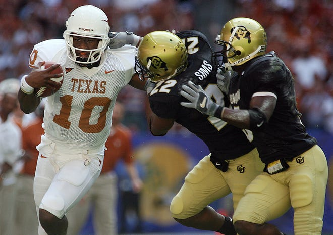 Texas quarterback Vince Young attempts to break away from Colorado's Lorenzo Sims and J.J. Billingsley during the 2005 Big 12 championship game in Houston. The win propelled the Longhorns into the national championship game.