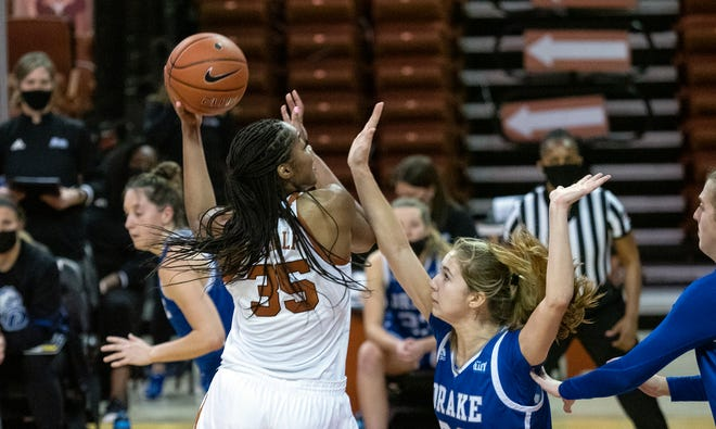 Texas junior Charli Collier shoots over Drake's Courtney Becke at the Erwin Center on Dec. 18.