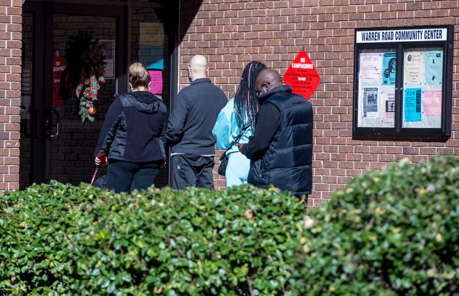 Voters line up to cast their ballots at the Warren Road Community Center on Monday morning. It is one of three satellite voting sites that opened Monday.