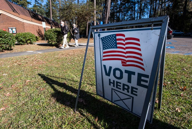 Voters make their way to the polls to vote early Dec. 28 in Augusta. In a voter registration case, Middle District Judge Leslie Abrams Gardner said recusing herself from a voter registration case would be a dereliction of duty.