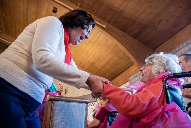 Donna DeQuila, financial manager at Luther Woods Nursing Home and Rehabilitation Center in Horsham, dances with Jeanine Pike, a resident, during a Sock Hop party Sunday, March 8, 2020.