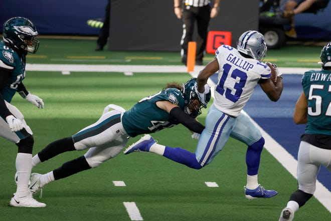 Dallas Cowboys wide receiver Michael Gallup (13) avoids the tackle attempt of Philadelphia Eagles linebacker Alex Singleton (49) for a touchdown in the first half of an NFL football game in Arlington, Texas, Sunday, Dec. 27. 2020. (AP Photo/Ron Jenkins)