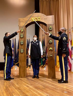 Sergeants from BJACH accept charge to lead at NCO Induction