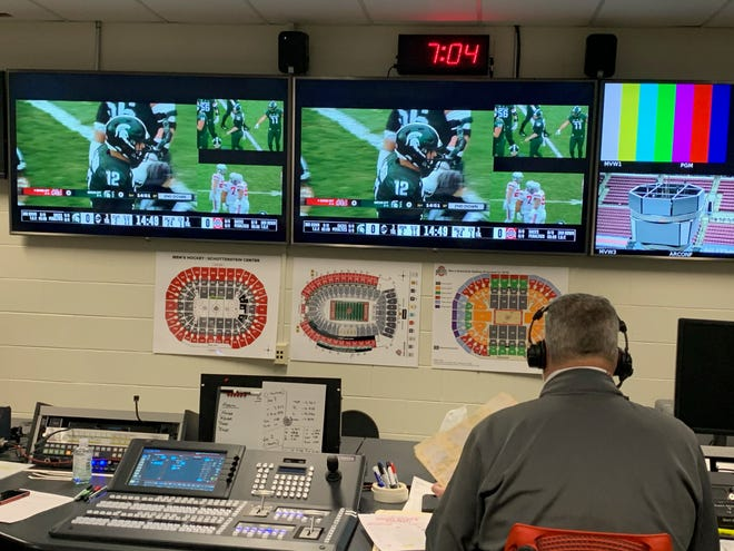 Ohio State radio play-by-play announcer Paul Keels calls the Buckeyes' game against Michigan State in East Lansing from a video production room in the Schottenstein Center.