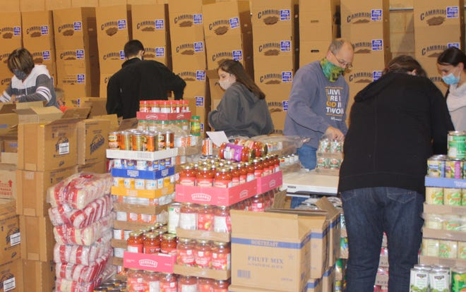 Byesville Rotary club members, friends, family members, and student volunteers met to fill baskets on Dec. 18. On Dec. 19, a drive-by distribution process allowed families to pick up their food baskets without getting out of their vehicles. Baskets were distributed to 200 families – totaling about 800 people that will be supported by the Christmas food baskets.
