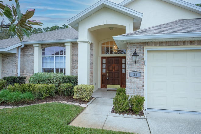 This well-cared-for brick pool home is located in the sought-after Hunters Ridge community.