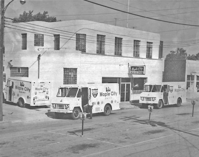 The fleet of delivery trucks is lined up in front of Maple City Dairy in the late 1960s. Photo courtesy of Jim Peterson.