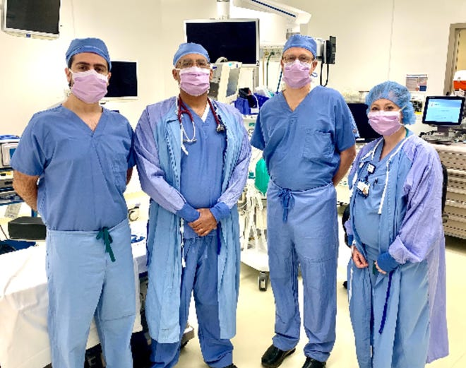 Dr. Asfandyar Khan (left and below) joins St. James general surgery team Dr. Ismail Mehr, Dr. Andrew Powers, and Courtney Quinlan, PA.