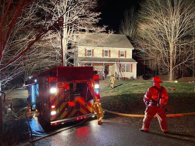 Dover firefighters respond to a house fire on Atina Way in Dover early Sunday morning.