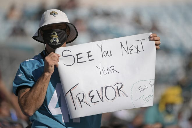 A Jaguars fan holds up a sign hoping that Clemson quarterback Trevor Lawrence will be the team's first pick in the 2021 NFL Draft.