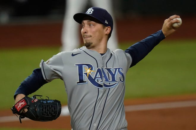 Tampa Bay Rays starting pitcher Blake Snell throws against the Los Angeles Dodgers during the first inning of Game 6 of the World Series, Tuesday, Oct. 27, 2020, in Arlington, Texas.