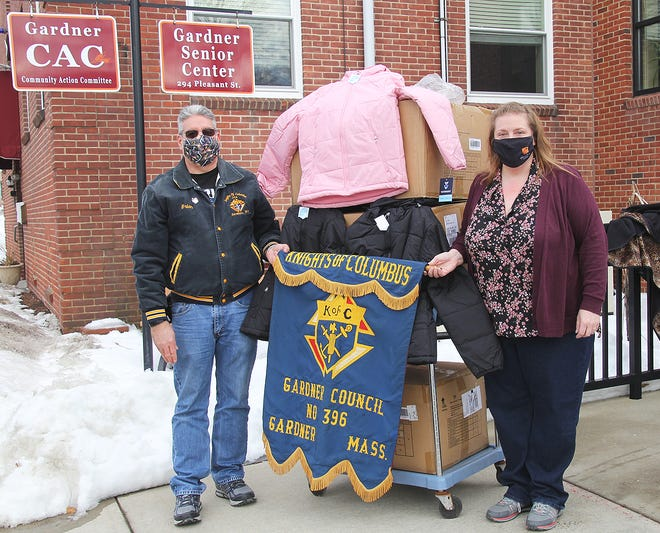 The Gardner Knights of Columbus Council No. 396 recently donated three cases of new winter coats to the Community Action Committee for distribution to needy children and families. There was one case of coats for young girls, one case for young boys, and a case of coats for teen boys and girls. Standing alongside some of the coats are CAC Executive Director Julie Meehan, right, and Brian Bourgeois, past grand knight and treasurer of Knights of Columbus Council No. 396.