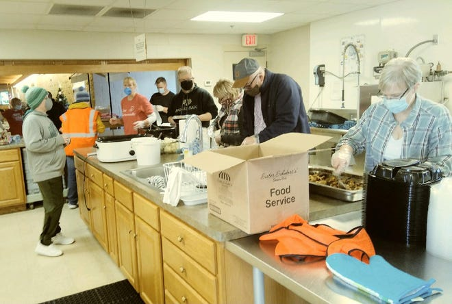 Volunteers spent several hours in the kitchen at First Lutheran Church in Geneseo on Christmas Day, providing carryout meals to 125 people.
