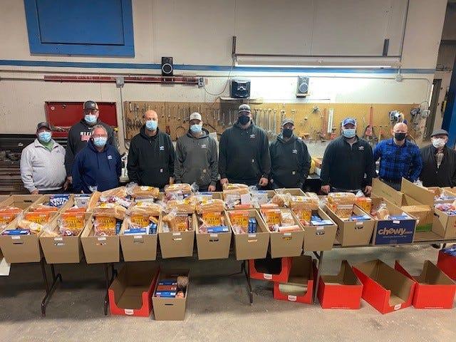 Galva Lions club and River Valley volunteers help load 108 food baskets