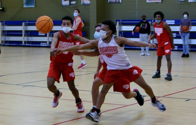 Hendersonville's Jordan Lynch (white jersey) and Keenan Wilkins go after the ball during Monday's practice at the Boys and Girls Club of Hendersonville.