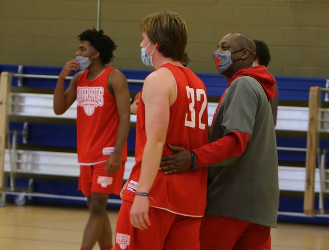 Hendersonville coach Marvin Featherstone, right, talks with Joel Christner as Dwight Canady looks on Monday at the Boys and Girls Club of Hendersonville.