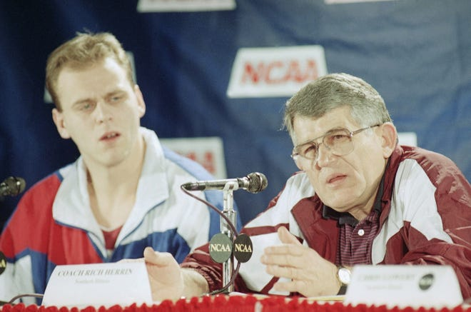 Southern Illinois coach Rich Herrin, right, talks to the media prior to their practice session on Thursday, March 17, 1994 at Arco Arena in Sacramento, Calif.
