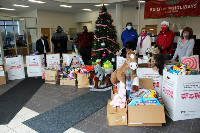 Henderson Ford employees and a U.S. Marine Corps Toys for Tots representative pose with toy donations for 2020. Pictured, from left, are DaMaris Corzatt, Brian Henderson, Rod Stevens, Melvin Rose, Beth DeCosmo, Jason Tiefel and Sue Degrazia.