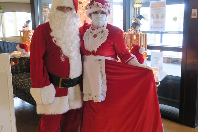 Santa and Mrs. Claus stop by Rochester Regional Health's Edna Tina Wilson Living Center to spread holiday cheer.