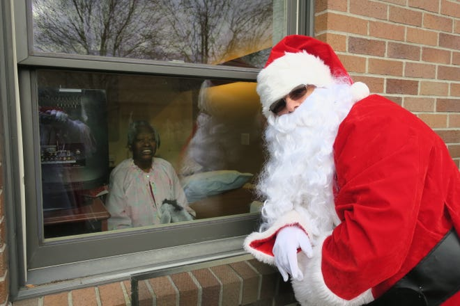 Santa Claus visits with residents of the Edna Tina Wilson Living Center.