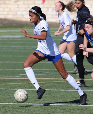 Heritage's Rachel Allen dribbles downfield during a 2020 game. The Jaguars are ranked No. 1 in both the girls' and boys' Class 4A Region II preseason polls by the Texas Association of Soccer Coaches.