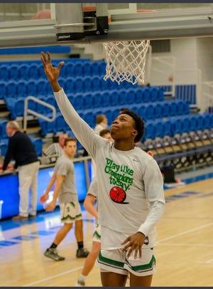 Sutton High School's varsity basketball player Harold Sartiah