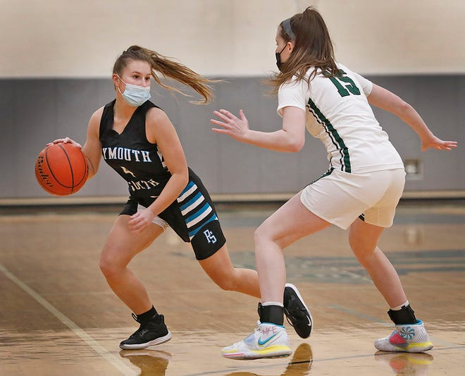 Panther captain Braley Quigg tries to make a move to the hoop past Dragon guard Molly Donovan.  Duxbury high girls host Plymouth South in basketball on Monday December 28, 2020