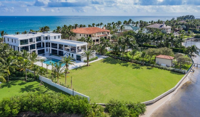 Former Palm Beachers Ron and Cindy McMackin were on the buyer's side of a just-closed Manalapan sale of a contemporary-style house on an ocean-to-lake lot at 1660 S. Ocean Blvd., seen at the left. The McMackins recently sold their Palm Beach home to Hollywood icon Sylvester Stalllone, who bought it using a trust.