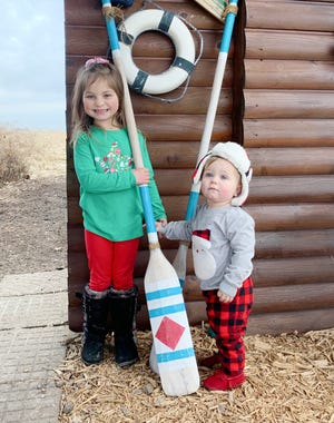 Emma Carlos, 5, and her brother Oliver, 1, paid a visiting the Reindeer Ranch as part of their celebration of the holidays. Parents are Tyler and Liz Carlos of Cornell.