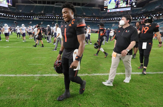 Miami Hurricanes quarterback D'Eriq King (1) walks off the field after UM's 62-26 loss to North Carolina at Hard Rock Stadium on Dec. 12.