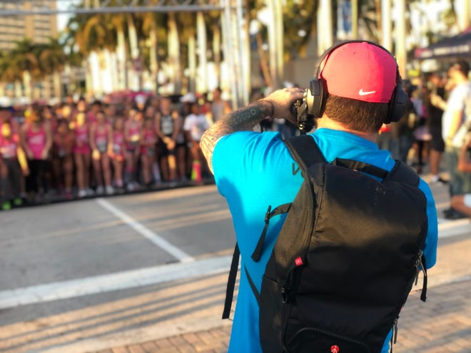 An LGW Mediaworks staff works the Susan G. Komen South Florida Race for the Cure on January 25.