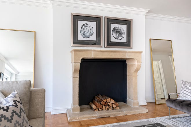 Cozy elements like a wood-burning fire or stove help create a sense of wintry charm.