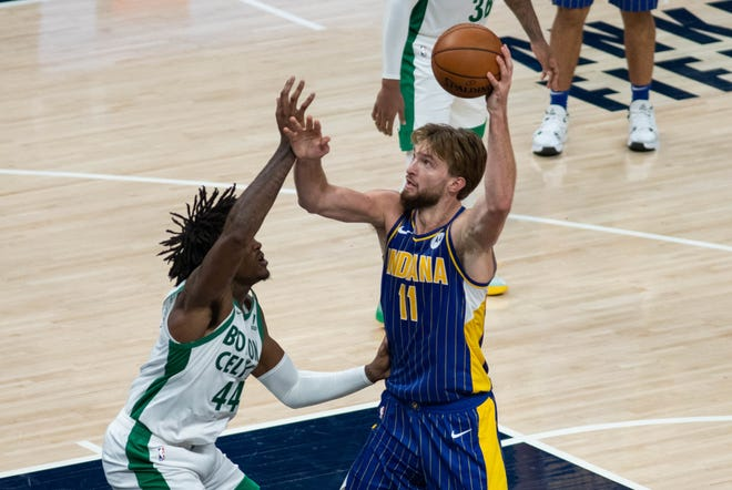 Indiana Pacers forward Domantas Sabonis (right) shoots over Celtics center Robert Williams III in the fourth quarter at Bankers Life Fieldhouse Sunday night.