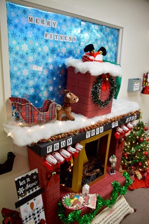 "The Physical Therapy's ""Merry Fitness"" door decoration display took 1st place in this year's Christmas decoration contest at Ballinger Memorial Hospital. The contest included the hospital, as well as Keel Drug and the Ballinger Clinic."