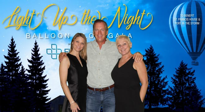 From left, Kerri Lang; Ed Dwyer, board member; and Judy Dembowski, executive director, at the Light Up the Night Balloon Glow Gala.