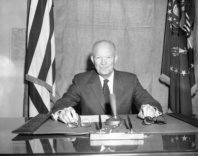President Dwight Eisenhower appears before a microphone in Key West on Jan. 5, 1956, as he records comment on the State of the Union message.