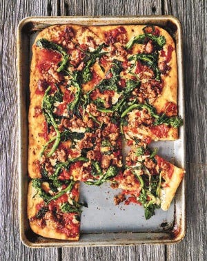 Broccoli rabe and sausage are on this deep-dish pie, but you could serve it with any toppings you like.
