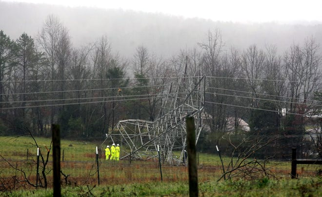Duke Power crews assess damage to transmission towers off Dixon School Road in Kings Mountain after tornadoes swept through the county in February.