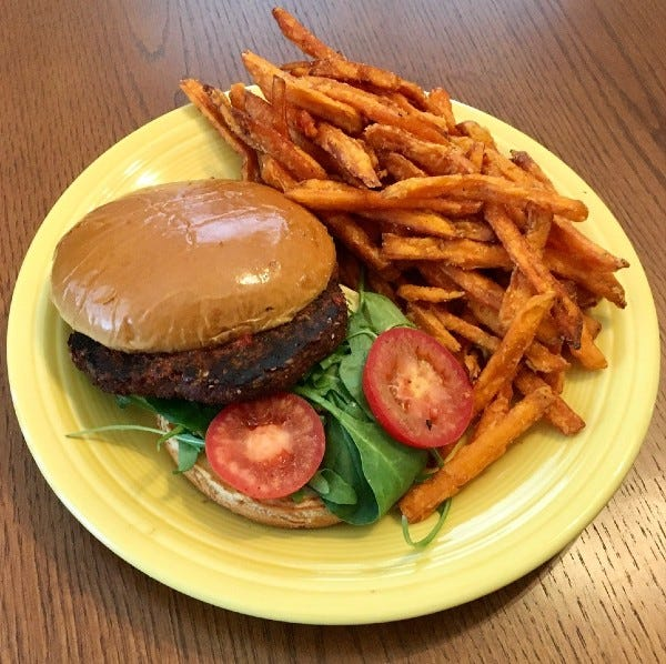 The Roasted Garlic Quinoa Burger with sweet-potato fries from the Farmhouse Restaurant at Harvest Market.