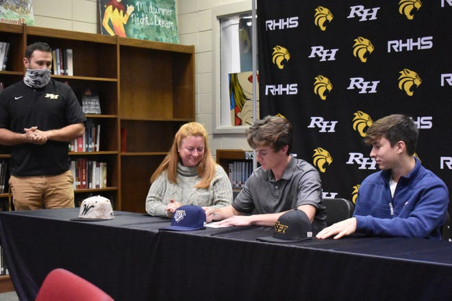 Mitch Cowan (center) signs on the dotted line as (from left) Richmond Hill High School baseball coach Scott Strickland, Mitch's mother Katherine Cowan and his brother Evan Cowan (far right) watch. [MIKE BROWN/FOR BRYAN COUNTY NOW]