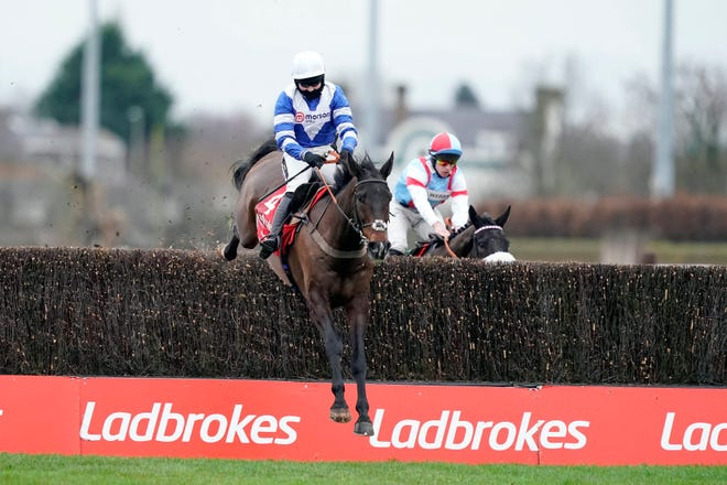 Bryony Frost riding Frodon, left, clear the last hedge to win the King George VI Chase Day of the Christmas Festival at Kempton Park Racecourse, Sunbury-on-Thames, England, Saturday, Dec. 26.