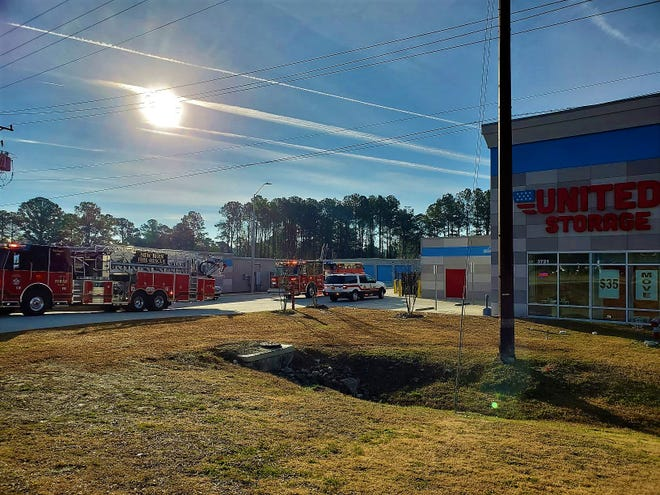 Firefighters were called to United Storage in New Bern Monday morning after one of the damaged units from a fire that occured on Dec. 19 began smoking again.
