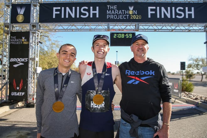Colin Bennie, left, is all smiles with his bronze medal, as are The Marathon Project winner Martin Hehir and Reebok Boston Track Club coach Chris Fox.