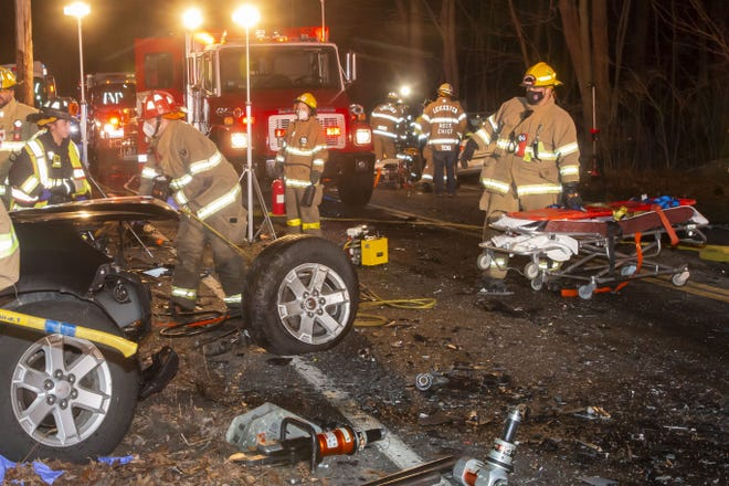 Firefighters and medical workers at the scene of a two-vehicle crash in Leicester Sunday evening.
