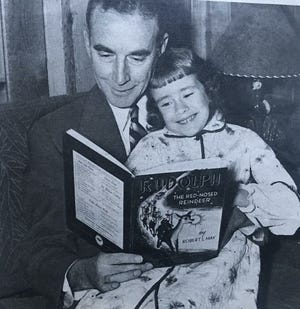 Robert L. May reads Rudolph The Red-Nosed Reindeer to his daughter, Martha May. May wrote the book in 1939 for the Montgomery Ward catalogue as a promotional item the business gave to customers. Chris May says Rudolph was modeled on his father's life.