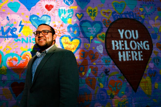 FILE - In this Tuesday, March 10, 2020 file photo, Ricky Hurtado, the first Latino candidate to run for North Carolina's House of Representatives, poses for a portrait by a mural in Graham, N.C. It's been a tumultuous few months for Hurtado. In November, the 32-year-old son of Salvadoran immigrant won a seat in the North Carolina state legislature as a Democrat representing a suburban slice of Alamance County. (AP Photo/Jacquelyn Martin)